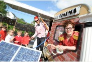 SWANSEA / Nino Thursday 19th May 2011 Usherette Beth Furlong and projectionist Jo Furlong welcome Year 1 pupils from Penclawdd Primary School queuing with tickets and popcorn for the World's smallest solar powered cinema - 'Sol Cinema' parked up in the school's playground.