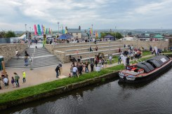 PIC BY BEN FURST/MERCURY PRESS (PICTURED: THE BURNLEY CANAL FESTIVAL LOCATED BY THE LEEDS-LIVEROOL CANAL )These beautiful pictures show families flooding the banks of Burnley canal to mark the 200th birthday of the Leeds-Liverpool waterway this Bank Holiday weekend. Artists joined dancers, bands, boaters and residents to stage a 'creative revolution' with an explosion of colour, art and family fun for this year's Burnley Canal Festival. To celebrate the bicentenary of the 127-mile canal, festival participants donned traditional Victorian dress while venues along the water were adorned with new artworks and performances. And while a myriad of colourful boats and barges filled the waterway, kids had the chance to decorate their own less water-resistant vessel made of cardboard. Drawing on the heritage of Burnley as a vital cog in the wheel on industrialisation, revellers were also treated to maypole dancing, Punch and Judy shows and folk dancing. SEE MERCURY COPY